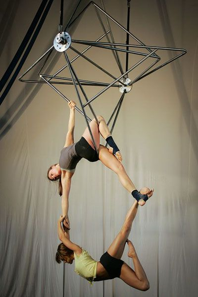Megan Stockman (top) and Devan Smith of Quixotic rehearse on a new apparatus built especially for Quixotics aerialists. Quixotic will perform with the Kansas City Symphony May 13th and 14th. JIM BARCUS/The Kansas City Star